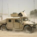 Electronic Warfare - military truck driving through sandy terrain